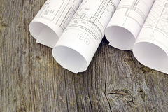 Project drawings on the background of wooden boards Royalty Free Stock Photos
