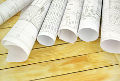 Project drawings on the background of wooden boards Stock Photo