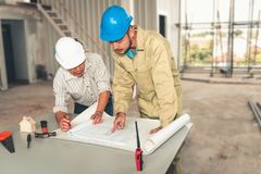 Project engineer team of construction industrial in site erection.,Project management team of engineer and architect planing for royalty free stock photo
