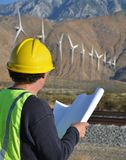 Project Engineer at Wind Farm. Man working at a wind turbine location Stock Image