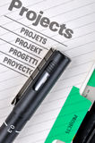 Project file and pen. Project book page or document and a pen, shown as project woking and other business concept Stock Photos