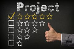 Project five 5 star rating. thumbs up service golden rating stars on chalkboard.  royalty free stock image