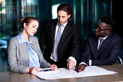 Project leader giving out guidelines to his team Stock Image