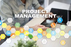 Project management concept, time and human resources, risks and quality and communication with icons on virtual screen. Project management concept, time and stock photo