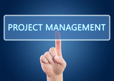 Project Management. Hand pressing Project Management button on interface with blue background Royalty Free Stock Photography