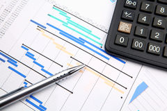 Project management. With pen and calculator Royalty Free Stock Photo