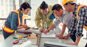 Project management team of engineers and achitects planing brain royalty free stock image