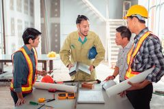 Project management team of engineers and architects discussing a stock images