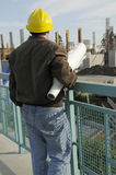 Project Manager. Man checking on current construction project Royalty Free Stock Photos