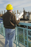 Project Manager. Man checking on current construction project Stock Photography