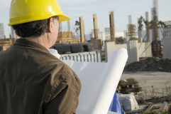 Project Manager. Man checking on current construction project Royalty Free Stock Images