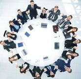 Project Manager and business team sitting at the round table. stock images