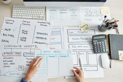 Free Project Manager Checking Application Layouts Stock Photography - 213977272