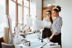 Free Project Manager Consultates Young Designer. Two Women In Design Studio Royalty Free Stock Photography - 138514047