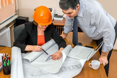 Project Manager and engineer discussing building plans. Discussion of the project. Group work Stock Image