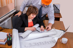 Project Manager instructs the engineer. Adjustment of the project. Meeting and the search for solutions Royalty Free Stock Photo