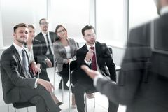 Project Manager makes a report for the business team. Business meeting stock photo