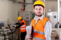 Project manager at production area. Young project manager at production area, horizontal Stock Image