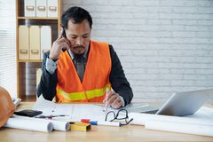 Project manager. Having phone call and taking notes royalty free stock photos