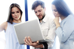 Project manager team discussing new idea.Business crew working with startup. Laptop, showing presentation, monitor. Young professionals work in modern office Royalty Free Stock Images