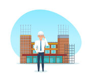 Project manager, with technical documentation, against background of under construction. Stock Photography