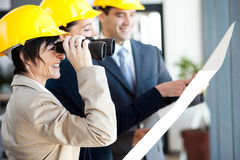 Project manager using binoculars Stock Photos