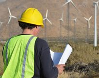 Project Manager at Wind Farm. Man working at a wind turbine location Stock Image
