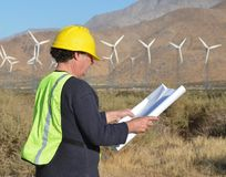 Project Manager at Wind Farm. Man working at a wind turbine location Stock Photography