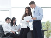 Project managers discuss the documentation. Project managers discuss new ideas Royalty Free Stock Photography