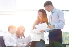 Project managers discuss the documentation. Project managers discuss new ideas Stock Photo