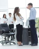 Project managers discuss the documentation. Project managers discuss new ideas Royalty Free Stock Image