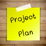 Project plan on sticky paper. On Brown wood plank wall texture background Stock Photos