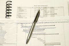 Project Planning and Schedule. Concept with graph and spiral notebook stock photo