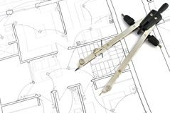 Project plans. Compass on housing project plans royalty free stock photography