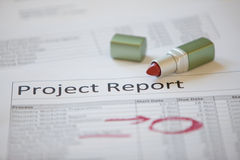 Project report marked up with lip stick Royalty Free Stock Photo