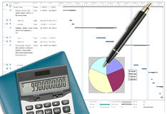 Project schedule analysis with pen, calculator & notebook. Project schedule analysis with pen, calculator & notebook on white paper planing Royalty Free Stock Photo