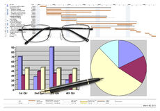 Project schedule with financial analysis, pen & eyeglasses. On white Royalty Free Stock Images