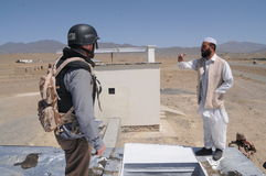Project site visit in Afghanistan. Civil engineer from the Czech Republic´s Provincial Reconstruction Team (PRT) in Logar Province (Afghanistan) checking the Stock Photo