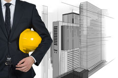 Project skyscraper. Businessman in yellow helmet and drawing project skyscraper stock images