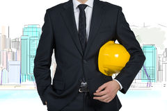 Project skyscraper. Businessman with yellow helmet and drawing project skyscraper stock photography