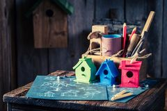 Project of small bird house and blue construction plan. Closeup of project of small bird house and blue construction plan Royalty Free Stock Image