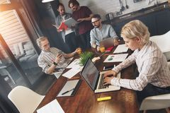 Project team working together in kitchen room. Teamwork at home. royalty free stock photo