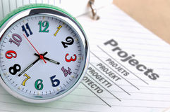 Project on time. A clock and a notepad project page, shown as time concept on project or woking focus on time manner Stock Photo