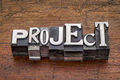 Project word in metal type. Project word in mixed vintage metal type printing blocks over grunge wood Royalty Free Stock Photo