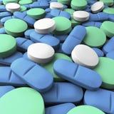 Projectile moyen de beaucoup de tablettes vertes, bleues et blanches Image libre de droits