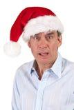 Projectile principal d'homme choqué dans le chapeau de Santa Photos stock