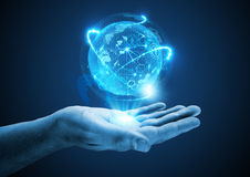 Projecting The Future. A hand holding a holographic projection Royalty Free Stock Photo