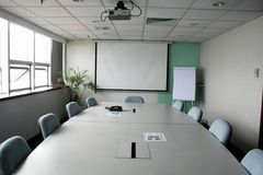 Projection screen in the boardroom Stock Image