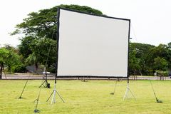 Projection screen. In the garden royalty free stock photo