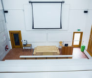 Projection screen in the lecture hall. High angle view of blank projection screen in the lecture hall stock photos